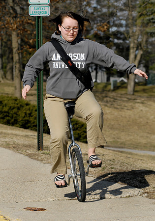 Anderson University senior Claire Brown, from Dayton, OH., works her way across campus to Nicholson Library on her unicycle Monday afternoon.  With the warmer temperatures Claire thought it would be a good day to break out the one-wheeler, but admitted the windy conditions made it more difficult to ride.