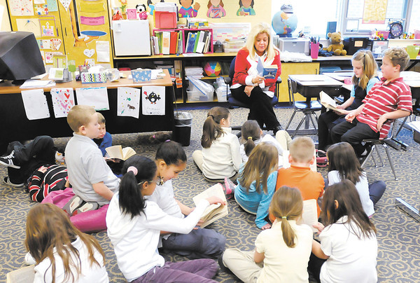 """Kristi Worley's reads the book """"Mr. Popper's Penguins"""" to her second grade class at Eastside Elementary on Thursday."""