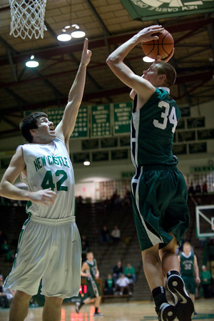 Pendleton Heights senior Kurt Talbert shoots over New Castle's Austin Orr. Pendleton Heights High School defeats New Castle at the fieldhouse 61 to 60 Tuesday, February 12, 2013. Photo by Richard Sitler