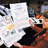 Indiana State Sen. Jean Leising shows some posters made by<br /> schoolchildren who<br /> support her legislation to require the teaching of cursive writing in<br /> Indiana schools.