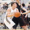 Lapel's Brady Cherry looks to pass as he is guarded by Cardinal Ritter's Jake Hagan on Friday.