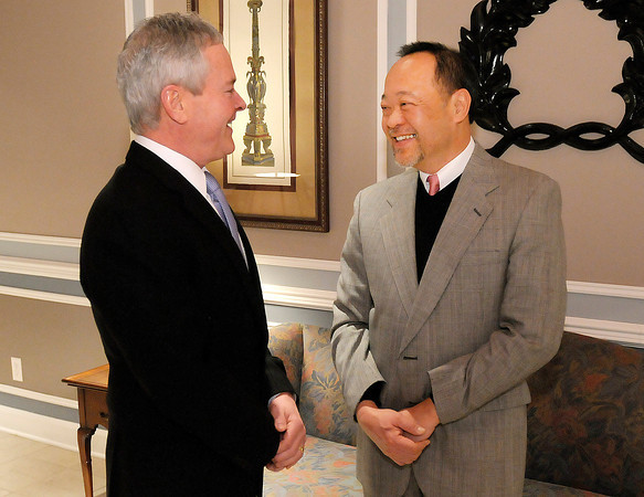 John Collier with RW Baird talks with Community Servant award winner Quang Vinh during the Madison County Leadership Academy graduation dinner at the Anderson Country Club on Thursday.