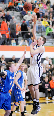 Anderson University's Nate Gross shoots over Mt. St. Joseph's David Mann as the Ravens hosted the Lions on Saturday.