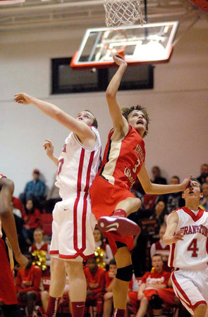 Liberty Christian junior guard Preston Quinn and Frankton junior Logan Weins battle for a rebound during the Eagles home game against the Lions.