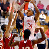 Liberty Christian's Franklin Nunn goes high in the lane for a shot jump shot.