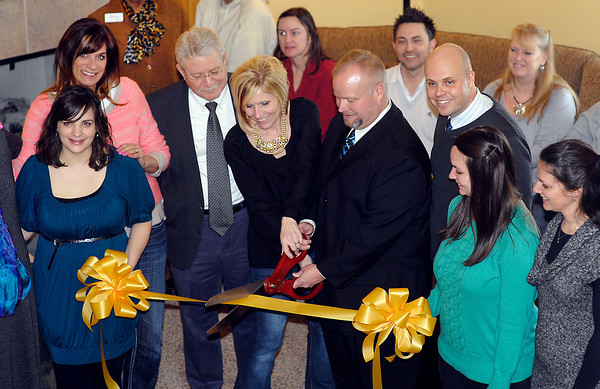 Misty Rees, founder of Selah House, and Amos Taylor, CEO, cut the ribbon at the grand opening.