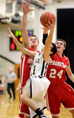Daleville's Sam Miller draws a foul from Frankton's Trevor Hughes (24) as he is guarded by Hughes and Jordan Reeves on Saturday.