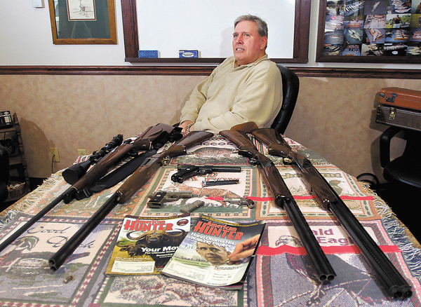 Jay Stapleton, local NRA supporter, with some of his guns he shoots with.