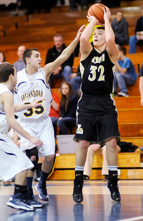 Lapel's Brady Cherry shoots as he is guarded by Moose Kirk on Thursday.