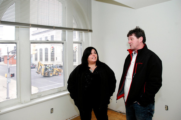 Juana Clark and Steve Martin, of Keller and Williams Realty, Carmel, look around the Tower Apartment building during their open house Monday.
