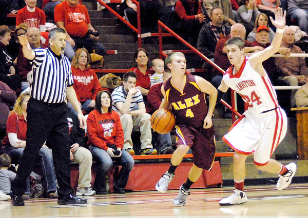 Alexandria junior Layton Carroll looks to make a pass while being guarded by Frankton senior Trevor Hughes.
