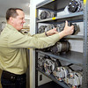 THB photo/John P. Cleary<br /> Randy Parker, owner of CPR, Inc., pulls a rebuilt alternator off the shelf at his business at 5129 Columbus Ave.