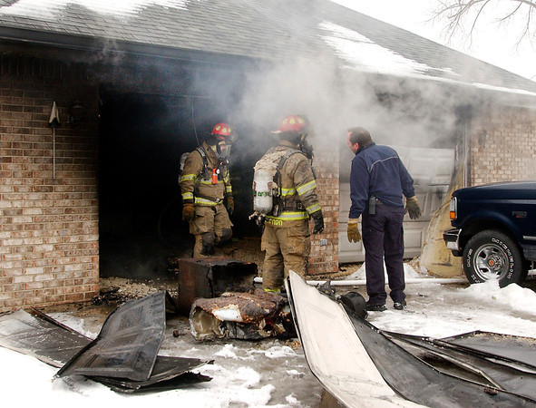 THB photo/John P. Cleary<br /> Anderson firefighters battled a garage fire Tuesday that spread to the house in the 900 block of Broadway.