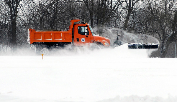THB photo/John P. Cleary<br /> Anderson Municipal Airport employee Steve Darlington makes a run down the north-south runway Wednesday pushing the snow off after a snow storm Tuesday night dumped around 8 inches over the area.