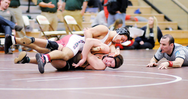 Don Knight / The Herald Bulletin<br /> Anderson's Zach Amos wrestles Hamilton Heights' Isaac Ray for the 145 pound championship during the sectional at Hamilton Heights on Saturday. Anderson finished second as a team with three champions including Amos.