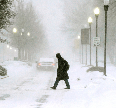 THB photo/John P. Cleary<br /> An Anderson University student crosses University Blvd. on campus as the snow started to fall at a heaver pace reducing visibility for the passing traffic.