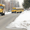 Don Knight / The Herald Bulletin<br /> School buses leave 10th Street Elementary at the end of the school day on Thursday. Anderson Community Schools has spent about $30,000 on snow removal so far this year, said Roger Shockley, director of Facilities, Health, Safety and Capital Projects.