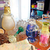 Don Knight / The Herald Bulletin<br /> From left, Stephanie Fertucci and her sister-in-law Nichole Sommers work on crafts to sell on Etsy. Garden decorations Stephanie Fertucci crafted by recycling old glassware.