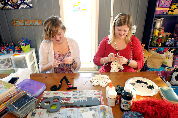 Don Knight / The Herald Bulletin<br /> From left, Stephanie Fertucci and her sister-in-law Nichole Sommers work on crafts to sell on Etsy.