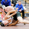 Don Knight / The Herald Bulletin<br /> Pendleton Heights' Spencer McCool wrestles Elwood's Sammy Mireles for the 170 pound championship during the wrestling sectional at Hamilton Heights on Saturday. McCool went on to win by decision.