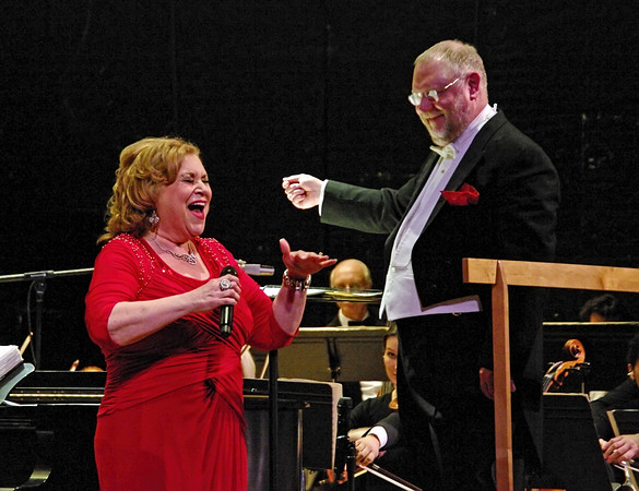 """Hometown girl Sandi Patty sings """"All of Me"""" as Richard Sowers turns and smiles as he conducts the Anderson Symphony Orchestra during the Valentine's Concert presented Saturday night at the Paramount Theatre."""