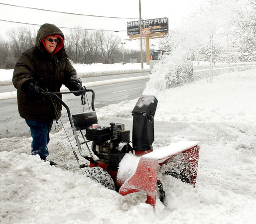 THB photo/John P. Cleary<br /> SUMMER FUN?  That's not what Al Bruner is thinking as he clears a driveway of snow Wednesday in the 500 block of Broadway in Anderson after a fresh 6-8 inches of the white stuff fell overnight.