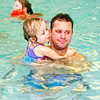 Mark Maynard / For The Herald Bulletin<br /> Brianna Studer hangs on tightlly to her dad, Tony, as they enjoy the pool at the Anderson Holiday Inn Express; Brianna suffers from O I.
