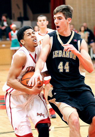 Photo by Chris Martin for THB<br /> Anderson's Thomas Wells is fouled driving to the basket Tuesday night against Lebanon.
