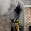 THB photo/John P. Cleary<br /> Anderson firefighters battled a smoky garage fire Tuesday that spread to the house in the 900 block of Broadway.