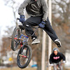 THB photo/John P. Cleary<br /> Even though the temperatures are colder the snow is gone from the Mays Park skate plaza where riders were out doing their tricks on their BMX bikes.  Here James Mitchum, 16, does his stunt off a ramp as Jalen Blaylock, 15, starts his run behind him.