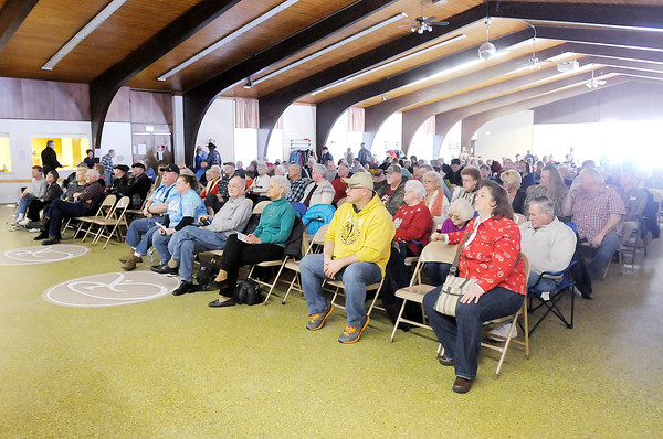 Don Knight / The Herald Bulletin<br /> About 200 people listen to Common Ground perform during the 25th Annual Snowflake Bluegrass Festival at the Rangeline Community Center on Saturday. Seven bands performed an hour each during the festival.