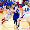 Photo by Bob Hickey<br /> Elwood's Jessie Noone drives to the basket as her teammate moves in to set a pick during the sectional championship game against Mt. Vernon at Elwood Saturday night.
