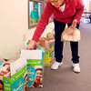 THB photo/John P. Cleary<br /> The Baby Corner volunteer Jane Murray picks out the diaper sizes for a client.