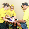 Mark Maynard / For The Herald Bulletin<br /> Michelle Hoppes, her daughter Kayte and Dr. Neel Desai demonstrate the construction of an emergency cast, which is a critical skill for parents of children with O I to master due to the high risk of fractures because of the disease.  Kayte, who is almost 13, has already suffered numerous broken bones during in her lifetime.