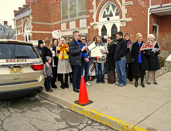 """Former choral director Adam Fraley leads Alexandria United Methodist Church congregation members in song during """"Sing Out Sunday"""" which was held to protest his termination due solely to his sexual orientation."""