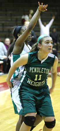 Photo by Chris Martin for THB<br /> Anderson's Debriona Williams hits a 3 over Pendleton's Sam Hammel