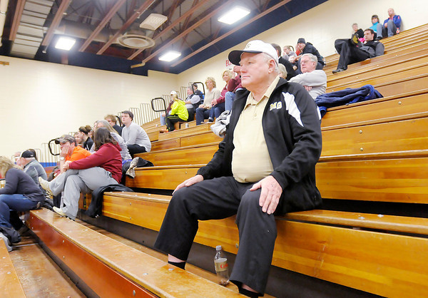 Don Knight / The Herald Bulletin<br /> Fairmount resident Arlen Hasty watches Madison-Grant as the faced Alexandria in sectional action at Elwood High School on last week. Hasty, a graduate of Fairmount High School, is a regular at Madison-Grant sporting events.