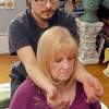 THB photo/John P. Cleary<br /> Josh Medlin gives a Shiatsu session to client Mary Harte.  Shiatsu looks a lot like Western massage and includes similar techniques such as stretches and compression.