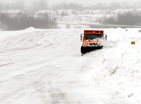 THB photo/John P. Cleary<br /> Anderson Municipal Airport employee Steve Darlington pushes back the snow along the edge of the main runway Wednesday after a snow storm Tuesday night dumped around 8 inches over the area.  It has been a challenging winter season for the airport trying to keep the runways, taxiways and ramp areas clear of snow without being able to use any salt because of it's corrosive properties that damage aircraft.