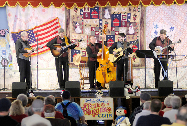 Don Knight / The Herald Bulletin<br /> Common Ground performs during the 25th Annual Snowflake Bluegrass Festival at the Rangeline Community Center on Saturday.