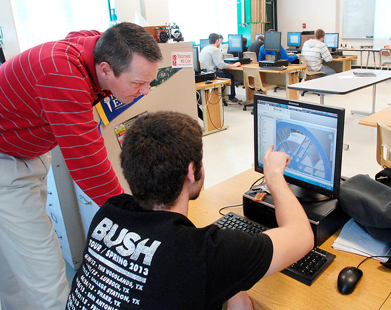 THB photo/John P. Cleary<br /> Pendleton Hts. High School Civil Engineering and Architecture instructor Martin Klipsch discusses Isaiah Reason's design with him during class Thursday.