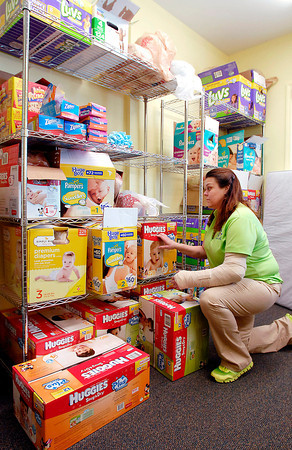 THB photo/John P. Cleary<br /> SuzieDee Pardue, of The Baby Corner at Christ Lutheran Church, checks their supply of diapers before they open.  Pardue says they will usually go through their inventory during the  four hours they are open. The Baby Corner is open every 3rd Tuesday of the month.