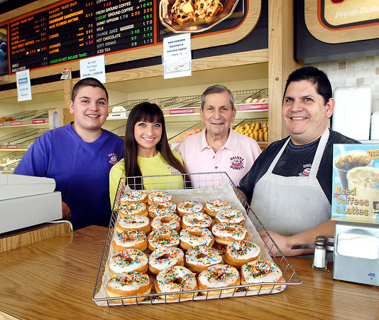 THB photo/John P. Cleary<br /> Deluxe Donuts is a Best Of winner with three generations working the business.  There are grandchilden Andrew Pancol and Stephanie Pancol, grandfather Jim Pancol, and son Lee Pancol.