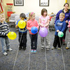 Don Knight / The Herald Bulletin<br /> Youth Services Librarian Lauren McPike instructs kids to release their rocket balloon during the Silly Scientists program at the Alexandria Library on Wednesday. The next Silly Scientists program is March 26th.