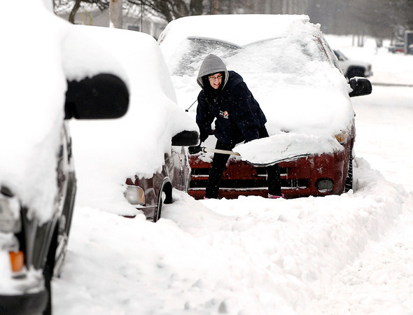 THB photo/John P. Cleary<br /> Cathy Sullivan digs out her van Wednesday morning in the 2100 block of Silver Street in Anderson after 6-8 inches of fresh snow fell overnight blanketing the area.