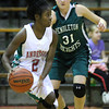 Photo by Chris Martin for THB<br /> Anderson's Donjanae Chamberlain tries to drive around Pendleton's Kelsey Burton Friday night in the sectional semi-final.