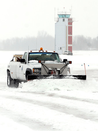 THB photo/John P. Cleary<br /> Anderson Municipal Airport employee Trent Saunders plows the hanger area Wednesday after a snow storm Tuesday night dumped around 8 inches over the area.