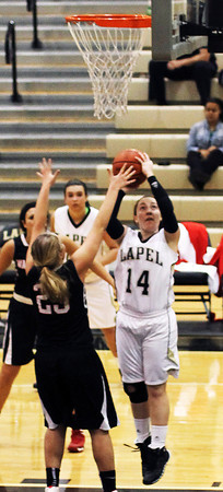 Photo by Chris Martin<br /> Lapel's Kirsten Rich shoots over Wapahani defenders.