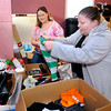 THB photo/John P. Cleary<br /> Kelli Cave and Jodi Allen go through boxes of donated household items they have received to photograph and post on facebook.