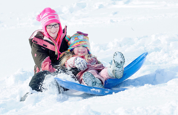 Don Knight / The Herald Bulletin<br /> Jena King, right, bumps into Emma Behrens while sledding on the back nine<br />  at Grandview Golf Corse on Wednesday.